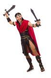 Gladiatore che posa con la spada isolata su bianco Immagine Stock Libera da Diritti