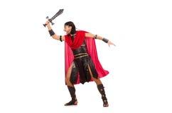Gladiatore che posa con la spada isolata su bianco Immagini Stock Libere da Diritti