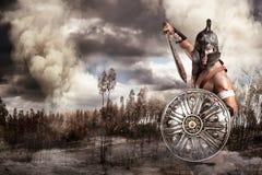 Gladiatore in una battaglia fotografia stock