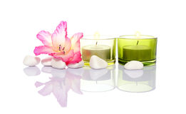 Gladiola,candles and river stones Royalty Free Stock Image