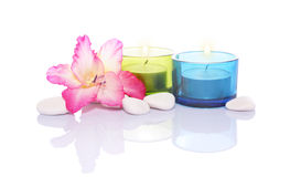 Gladiola,candles and river stones Stock Photo