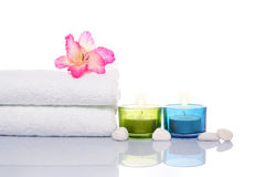 Gladiola, Candles, Towel and White Stones Royalty Free Stock Photography