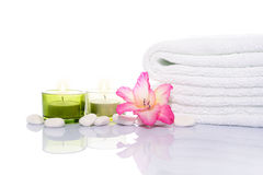 Gladiola, Candles, Towel and White Stones Royalty Free Stock Photos
