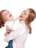 gladlynt barn henne skrattmom royaltyfri fotografi