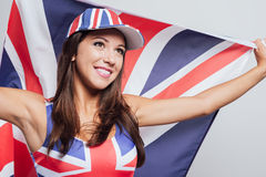 Gladlynt engelsk flicka med en flagga Royaltyfria Bilder