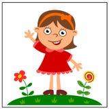 Gladlynt flicka i röd klänning på en grön äng med blommor arkivbild