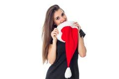 Gladlynt flicka i Santa Hat Fotografering för Bildbyråer