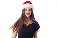 Gladlynt flicka i Santa Hat Arkivfoton
