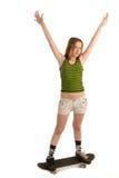 Gladlynt flicka på skateboarden Royaltyfri Bild