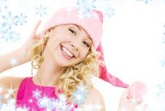 gladlynt flickahjälpreda santa fotografering för bildbyråer
