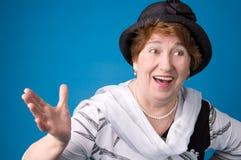 gladlynt gammalare kvinna Fotografering för Bildbyråer