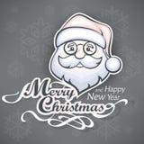 Gladlynt jultomtenframsida på grå färger Royaltyfri Fotografi