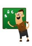 Gladlynt lärare som pekar till svart tavla Arkivfoton