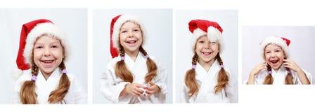 Gladlynt liten flicka fyra år med den Santa Claus beanien på hans huvud Arkivfoton