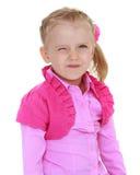 Gladlynt liten flicka som blinkar ögat Royaltyfri Foto