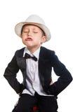 Gladlynt pojke i en smoking och en hatt fotografering för bildbyråer