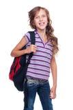 Gladlynt schoolgirl med ryggsäcken Arkivfoton