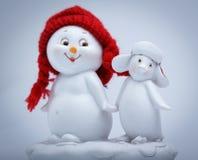 Gladlynt snögubbe och pingvin Arkivbilder