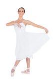 Gladlynt ungt posera för balettdansör arkivfoton