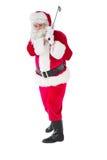 Gladlynta Santa Claus som spelar golf Royaltyfri Fotografi