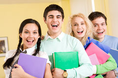 Gladness. Portrait of happy students laughing next to each other stock photos