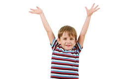 Gladness. Portrait of joyful boy looking at camera with raised arms royalty free stock photos