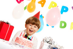Gladness. Portrait of happy boy looking at camera and laughing on birthday party royalty free stock photography