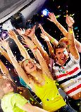 Gladness. Photo of excited teenagers raising their arms in joy stock photos