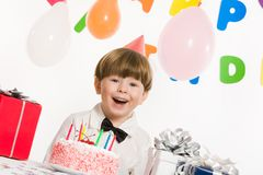 Gladness. Portrait of happy boy looking at camera and laughing on birthday party royalty free stock photo