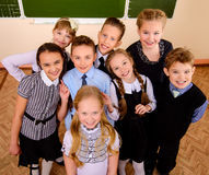 Gladness. Happy schoolchildren at a classroom. Education stock images