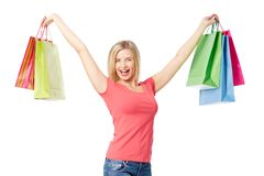 Gladness. Portrait of happy female raising arms with colorful paperbags over white background stock image