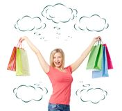 Gladness. Portrait of happy female raising arms with colorful paperbags over white background royalty free stock photo