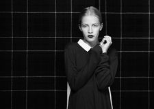 Glam. Attractive Female Hipster in Shadows posing Royalty Free Stock Photography