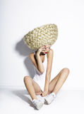 Glam. Exceptional Hair-do. Artistic Woman with Plaited White Art Wig. Glamorous Hairdo. Young Woman with Plaited White Big Peruke sitting on the Floor Royalty Free Stock Images