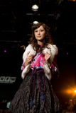 Glam female model at a fashion show(Russian Fashio stock photos