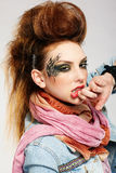 Glam punk girl. Portrait of glam punk redhead girl wiping her lips Royalty Free Stock Images