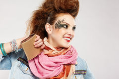 Glam punk girl. Portrait of glam punk redhead girl posing on gray Royalty Free Stock Image