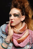 Glam punk girl smoking Stock Photos