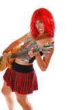 Glam Rock GirlOn Bass. Red headed Glam Rock Girl jamming on the bass guitar Royalty Free Stock Photo