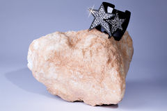 Glam Rock. Glitter jewelled bracelet bling jewellery on rock. 70 Royalty Free Stock Image