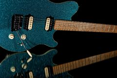 Glam rock guitar. Electric guitar with vibrant blue glitter fini Royalty Free Stock Photos