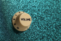 Glam rock guitar volume control close up. The volume knob from a glam rock guitar. The combination of volume and brightness signifies youth; vitality and Royalty Free Stock Photo
