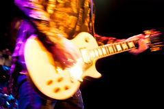 Rock guitarist. Motion blur abstract of a rock guitarist wearing glitter clothing Royalty Free Stock Photography