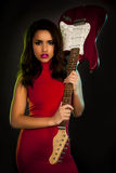 Glam rocker. Fashion girl with guitar over a black background Stock Photography