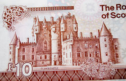 Glamis Castle on banknote. Detail of a Royal Bank of Scotland ten pound note showing the historic Glamis Castle.  Reputedly the site of Macbeth's murder of King Stock Image