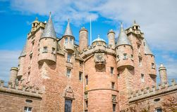 Glamis Castle in a sunny day, Angus, Scotland. Glamis Castle is situated beside the village of Glamis in Angus, Scotland. It is the home of the Earl and Royalty Free Stock Photography