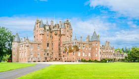 Glamis Castle in a sunny day, Angus, Scotland. Glamis Castle is situated beside the village of Glamis in Angus, Scotland. It is the home of the Earl and Royalty Free Stock Photo