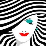 Glamorös flicka i en randig hatt Arkivfoton