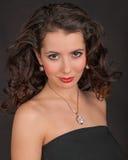 Kvinna i smycken Royaltyfria Bilder