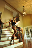 Glamor blond girl posing pretty at old fashioned house interior Stock Images